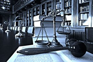Scales of justice with a gavel and books